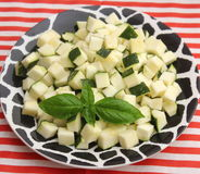 Zucchini. Some cubes of raw zucchini on a plate Royalty Free Stock Photos