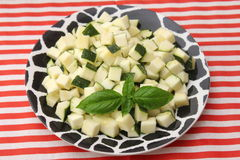 Zucchini. Some cubes of raw zucchini on a plate Stock Image