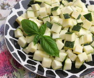 Zucchini. Some cubes of raw zucchini on a plate Stock Photo