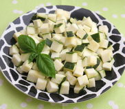 Zucchini. Some cubes of raw zucchini on a plate Stock Photography