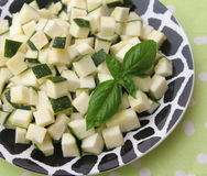 Zucchini. Some raw cubes of zucchini on a plate Stock Photography