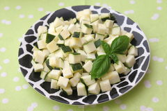 Zucchini. Some raw cubes of zucchini on a plate Royalty Free Stock Photography