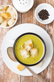 Zucchini soup with croutons, selective focus, top view Stock Photos