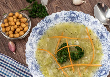 Zucchini soup with leeks and potatoes decorated with grated carrots and fresh parsley Stock Photos