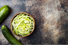 Zucchini spaghetti or noodles zoodles bowl with green veggies. Top view, overhead, copy space. Zucchini spaghetti or noodles zoodles bowl. Top view, copy space Royalty Free Stock Image