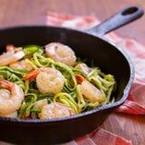 Zucchini spaghetti with shrimp Stock Images