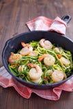 Zucchini spaghetti with shrimp Stock Image