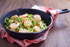 Zucchini spaghetti with shrimp Stock Photos