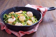Zucchini spaghetti with shrimp. Low carb zucchini spaghetti with shrimp in a pan Stock Photos