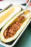 Zucchini with spicy meat stuffing Stock Photo