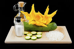Zucchini with squash blossoms and rice. To preparing tasty risotto stock image