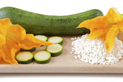 Zucchini with squash blossoms and rice. To preparing tasty risotto stock photos