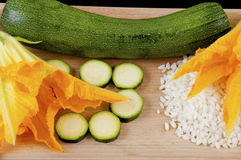 Zucchini with squash blossoms and rice Royalty Free Stock Images