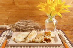 Zucchini with squash blossoms and rice. To preparing tasty risotto royalty free stock photos