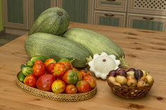 Zucchini, squash, tomatoes and cucumbers on the table. In the kitchen in the countryside Stock Photo