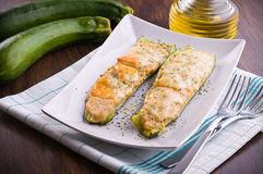 Zucchini stuffed with cheese. Image of a zucchini stuffed with cheese Royalty Free Stock Images