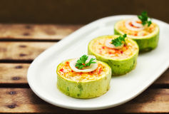 Zucchini stuffed with cheese and vegetables Stock Photos