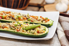 Zucchini stuffed with couscous vegetable salad Stock Photo