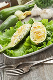 Zucchini stuffed with curd cheese Stock Photo