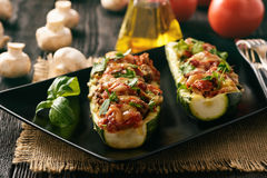 Zucchini stuffed with minced meat, cheese and mushroom. Baked in oven. Royalty Free Stock Photo
