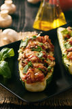 Zucchini stuffed with minced meat, cheese and mushroom. Baked in oven. Royalty Free Stock Image