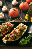Zucchini stuffed with minced meat, cheese and mushroom. Baked in oven. Stock Photography