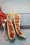 Zucchini stuffed with rice and vegetables Stock Photo