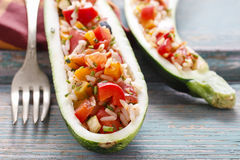 Zucchini stuffed with rice and vegetables Royalty Free Stock Image