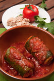 Zucchini stuffed with tuna. A typical dish of traditional Roman and Italian cuisine made from zucchini, tuna, bread crumbs and tomato sauce Stock Images