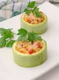 Zucchini stuffed with vegetables with rice and cheese Royalty Free Stock Images