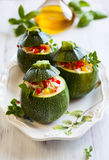 Zucchini stuffed with vegetables Stock Images
