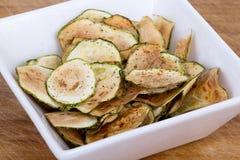 Zucchini thin chips. Slice on bowl Stock Photo