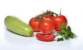 Zucchini and tomato and chili pepper and parsley. Zucchini tomato pepper parsle vegetarian Stock Image
