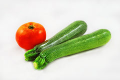 Zucchini with tomato Stock Images