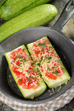 Zucchini. With tomatoes and cheese in a pan Stock Images