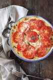 Zucchini and tomatoes gratin with bechamel sauce and cheese Stock Images