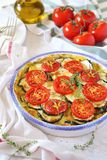 Zucchini and tomatoes gratin with bechamel sauce. And cheese Stock Photo