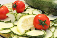 Zucchini tomatoes and lemon Stock Image