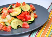 Zucchini Vegetable Plate. Dish of Zucchini Slices, tomatos, onions and cheese Stock Images