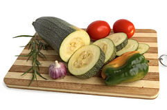 Zucchini with vegetables on the board Stock Photo