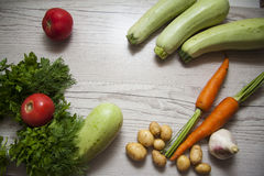 Zucchini vegetables and tomato with copy space Stock Images