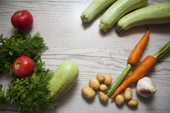 Zucchini vegetables and tomato with copy space Royalty Free Stock Photography
