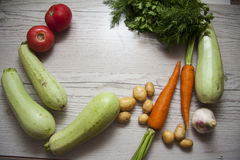Zucchini vegetables and tomato with copy space Royalty Free Stock Photos