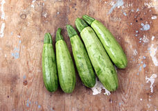 Zucchini. On a wooden background royalty free stock photos