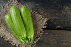 Zucchini. On a wooden table Stock Photography