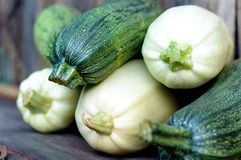 Zucchini on  wooden table Stock Images