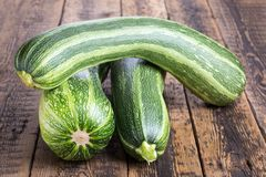 Zucchini on wooden table stock image