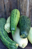 Zucchini on the wooden table Stock Image