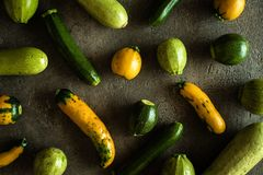 Zucchini Yellow and Green on Rustic Dark Background. Circulation and Healthy Heart Support stock images
