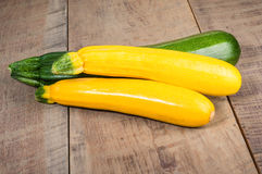 Zucchini and yellow squash on table Stock Image